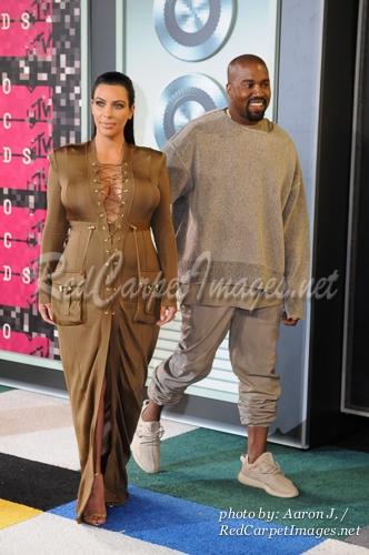 TV Personality Kim Kardashian and Rapper Kanye West
