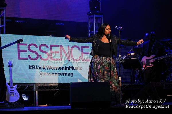 Singer Jazmine Sullivan performing on stage