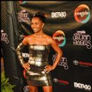 Singer Chili (TLC) poses on the red carpet