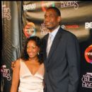 Former NBA Center Dikembe Mutombo and guest on the red carpet