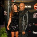Peabo Bryson and guest on the red carpet at the 2010 Soul Train Awards