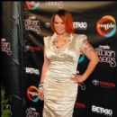Faith Evans poses on the carpet at the 2010 Soul Train Awards