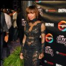 Actress Elise Neal stops for photos on the red carpet
