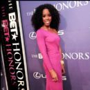 Singer Kelly Rowland shows off her dress at the BET Honors