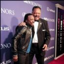 Singer Anthony Hamilton and Rev Jesse Jackson share a laugh on the carpet of the 2012 BET Honors