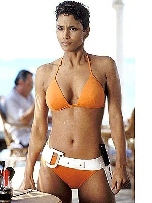 Halle Berry looks stunning in an orange bikini