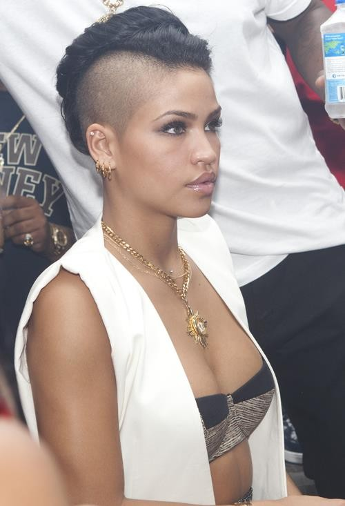 Cassie is going hard with the shaved head look!