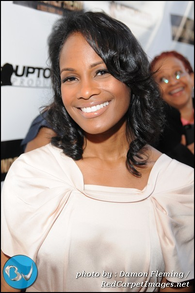 Actress Robinne Lee smiles for Photographers as she arrives to the screening of The Shepherd