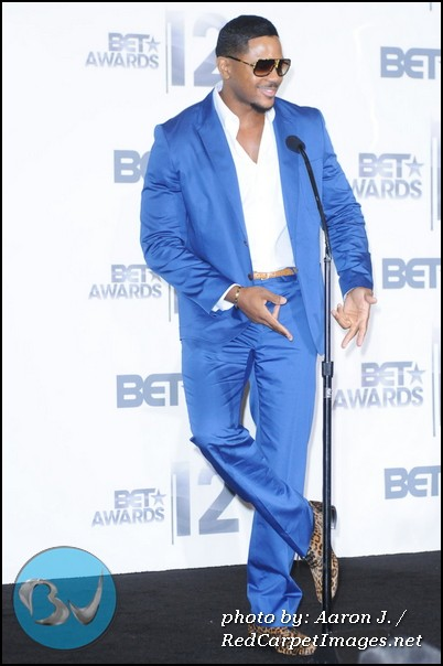 Actor Hosea Chanchez (The Game) shows off his stylish attire at the 2012 BET Awards