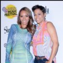 Newlywed Evelyn Lozada and fellow reality tv star Shaunie O'Neal backstage at Convention Center
