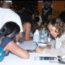 Actress Elise Neal signs autographs for fans in the Convention Center