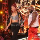 Rick Ross and Meek Mill perform during BET Rip the Runway