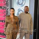 TV Personality Kim Kardashian and Rapper Kanye West