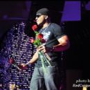 LL Cool J prepares to throw roses to the ladies in the Superdome crowd