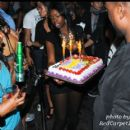 The cake arrives to the VIP section where Willis and Friends celebrate his Birthday