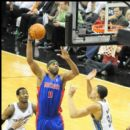 Chris Wilcox of the Pistons shoots over Wizards JaVale McGee