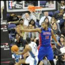 Wizards Mustafa Shakur drives against Pistons Greg Monroe
