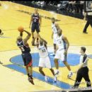 Hawks Damien Wilkins shoots the fade-a-way over Wizards Larry Owens