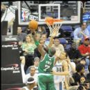 Celtics Jermaine O'Neal rises for the shot over JaVale McGee
