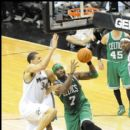 Celtics Jermaine O'Neal goes up for the layup on Wizards JaVale McGee