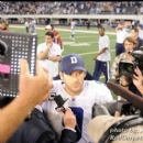 QB Tony Romo speaks to interviewers after the game