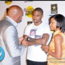 Steve Harvey speaks backstage with Trey Songz and his Mother