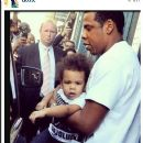 Jay-Z and Blue Ivy push through the paparazzi