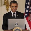 President Barack Obama works on his tech skills