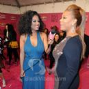 Singer Claudette Ortiz inteviewing Actress/Rapper/Producer Queen Latifah